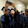 TIM JEAN/Staff photo. Alexandra Doherty takes a selfi with her friends before the start of Methuen High School commencement exercises at the Tsongas Arena in Lowell.   6/6/15