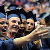 TIM JEAN/Staff photo. Graduates take a selfi during Methuen High School commencement exercises at the Tsongas Arena in Lowell.   6/6/15