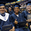 TIM JEAN/Staff photo. Flashing their diplomas from left to right are, Ryan Adams, Jonathan Abraham and Haley Abernathy during Methuen High School commencement exercises at the Tsongas Arena in Lowell.   6/6/15