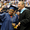 TIM JEAN/Staff photo. Alexa Payamps waves toward her family after receiving her Honors tassel from James Giuca, Principal during Methuen High School commencement exercises at the Tsongas Arena in Lowell.   6/6/15