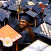 TIM JEAN/Staff photo. A graduate looks back toward her friends during Methuen High School commencement exercises at the Tsongas Arena in Lowell.   6/6/15