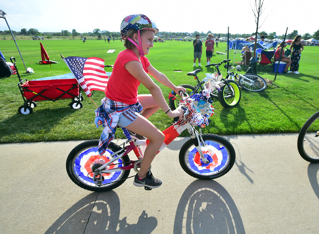 . Paige DeCamp, 10, rides her red, white and blue bike in the annual Bike Parade at the Great American Picnic at the Broomfield County Commons on Wednesday July 4. For more photos go to broomfieldenterprise.com.  Paul Aiken / Staff Photographer July 4, 2018