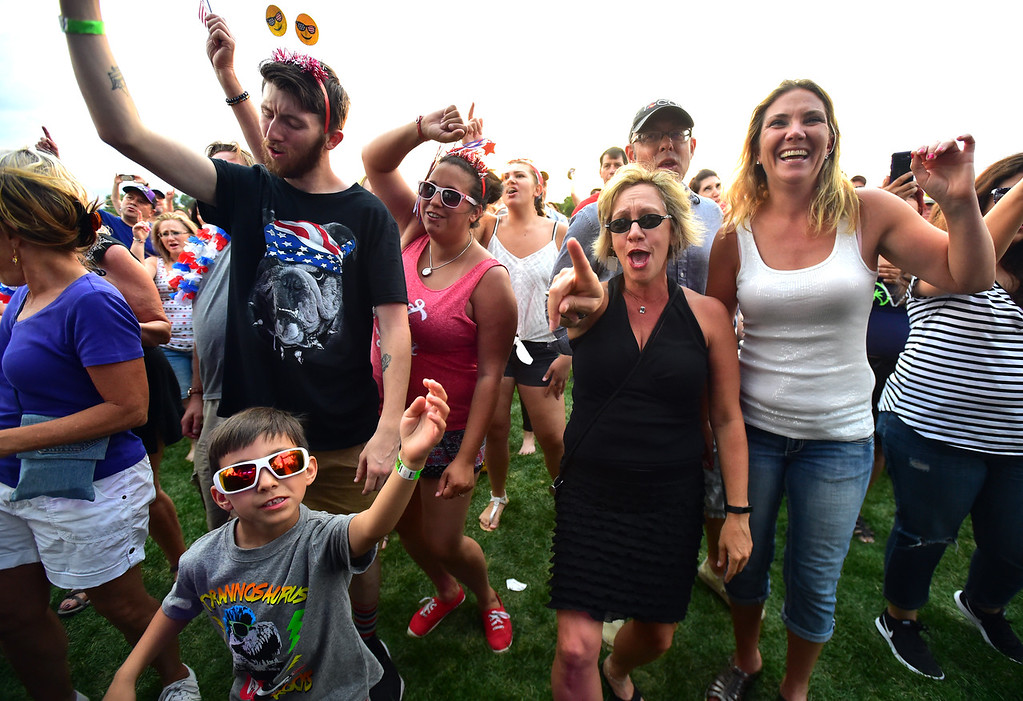 . From left to right, Kenneth, Amy and Eli Ness age 6, and Jenn Taylor and Francine Anderson, at right, dance to the music at the Great American Picnic at the Broomfield County Commons on Wednesday July 4. For more photos go to broomfieldenterprise.com.  Paul Aiken / Staff Photographer July 4, 2018