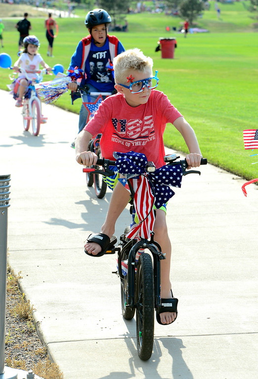 . Evan Loveland rides his bike in the annual Bike Parade at  the Great American Picnic at the Broomfield County Commons on Wednesday July 4. For more photos go to broomfieldenterprise.com.  Paul Aiken / Staff Photographer July 4, 2018