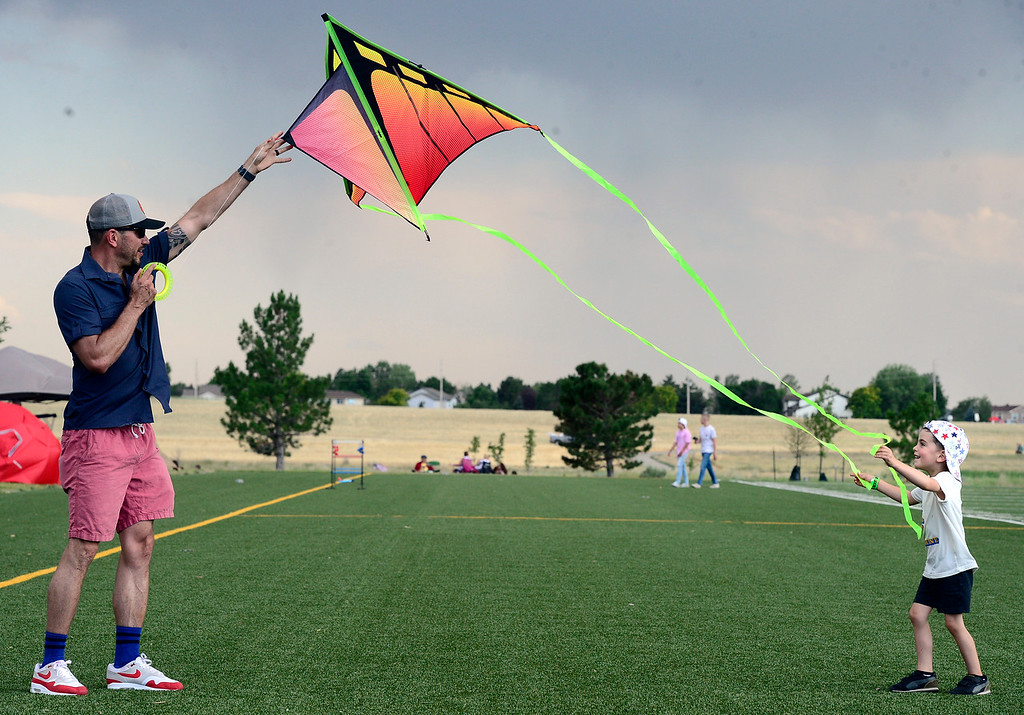 . Rockwell Hahn, 4, helps his dad Steve fly a kite at the Great American Picnic at the Broomfield County Commons on Wednesday July 4. For more photos go to broomfieldenterprise.com.  Paul Aiken / Staff Photographer July 4, 2018