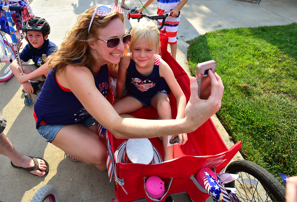 . Jenny Loveland gets a selfie with her daughter Kaira, 6, before the Bike Parade at the Great American Picnic at the Broomfield County Commons on Wednesday July 4. For more photos go to broomfieldenterprise.com.  Paul Aiken / Staff Photographer July 4, 2018