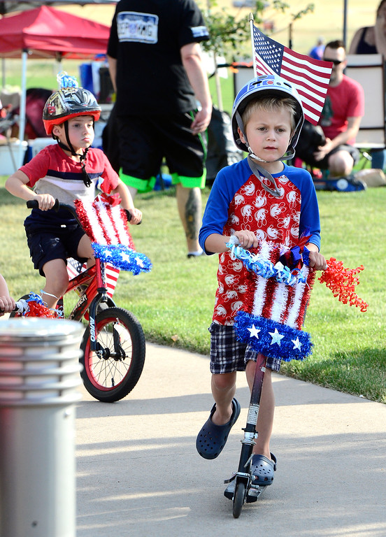 . Cooper DeDominces rides his red, white, and blue scooter at the Great American Picnic at the Broomfield County Commons on Wednesday July 4. For more photos go to broomfieldenterprise.com.  Paul Aiken / Staff Photographer July 4, 2018