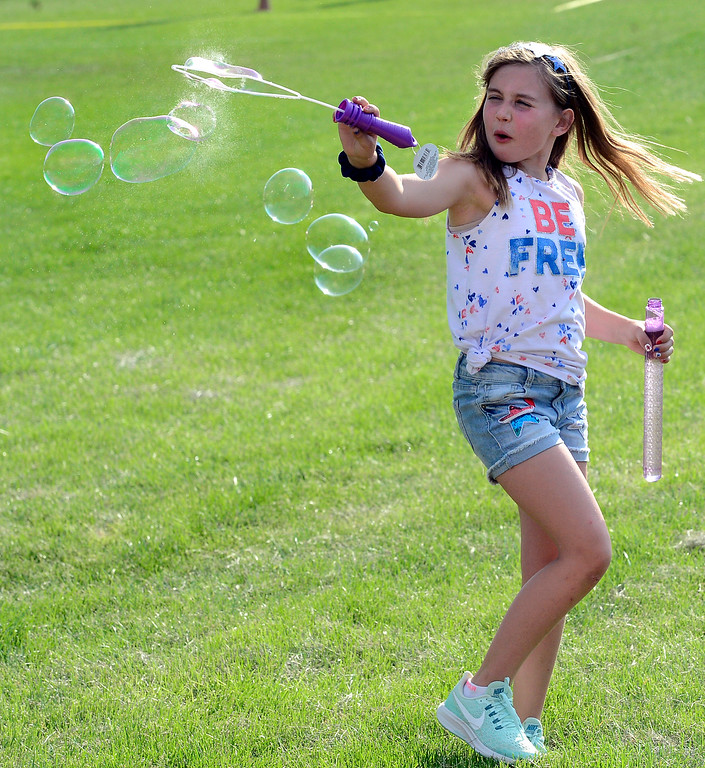 . Felice White makes bubbles at the Great American Picnic at the Broomfield County Commons on Wednesday July 4. For more photos go to broomfieldenterprise.com.  Paul Aiken / Staff Photographer July 4, 2018