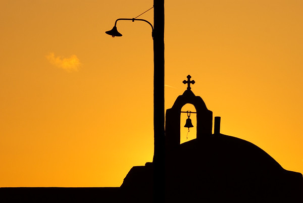 Chapel and street light silhouettes in the sunset