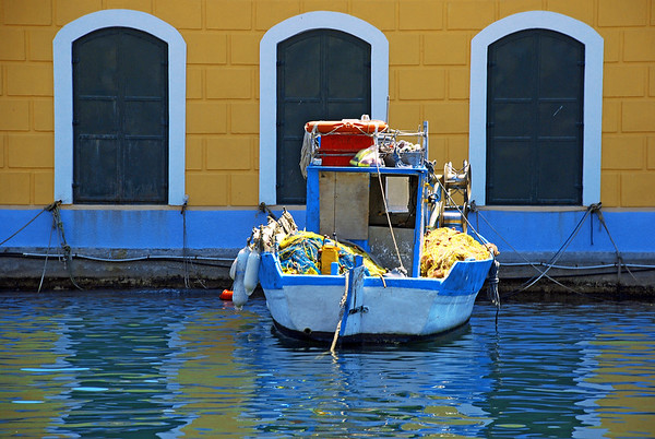 Fisherboat floating on Symi island waters