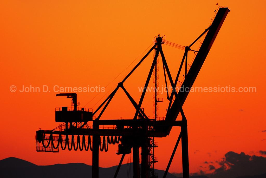 Crane in the sunset, Perama port