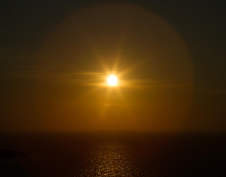 MAGICAL SUNSET GLOBE. Santorini, Greece.