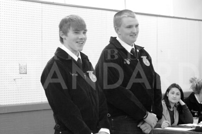 BARBARA ANNE GREENE Greybull high school students and Paintrock FFA members Bridger Clark and Will Dalin hope for high bids at the Labor Auction