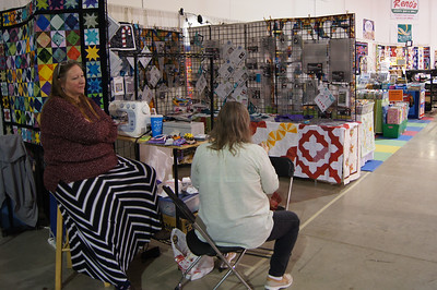 Custom Quilts of Haslett during a quiet moment.   Big selection of Creative Grid rulers.