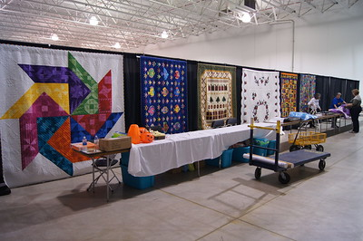 Raffle quilts.  Six are showing, one more to be displayed.