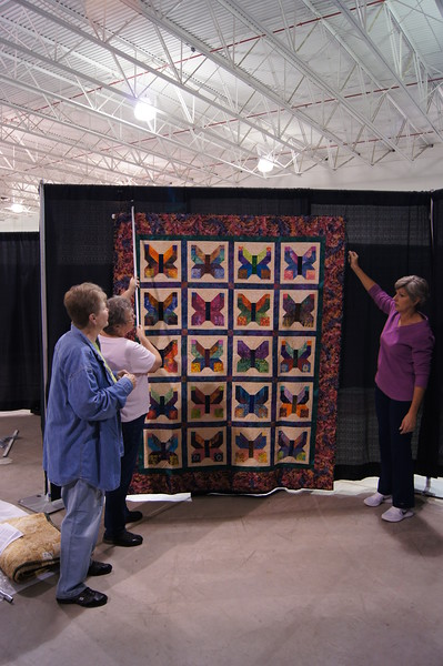 TA DA!!! The first quilt is hung.  Just 259 to go.