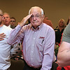 Allan Bowers a retired Airforce Major from Roylston salutes as the National anthem is sung by the International Veteran's Chorus at the GVNA HealthCare 7th Annual Executive Leadership Breakfast at Great Wolf Lodge on Thursday morning in Fitchburg. SENTINEL & ENTERPRISE/JOHN LOVE