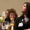 RN Dayna Girauard watches a slideshow from Dan Schawbel the guest speaker at the Gardner Visiting Nurses Associations 8th Annual Executive Leadership Breakfast at Great Wolf Lodge New England on Thursday, October 19, 2017. SENTINEL & ENTERPRISE/JOHN LOVE