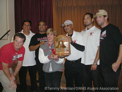 Washington varsity football staff: Alex Ware, Rick Care, Head Coach Karl Finley, Principal Ericka Lovrin, John Roy, Luis Espinoza, Tim Sonnenberg