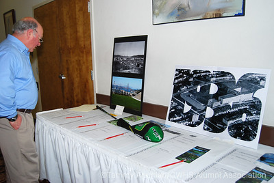 Marc looks at silent auction items
