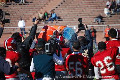 GW Head Coach Karl Finley receives the inevitable winning coach's sports-drink shower