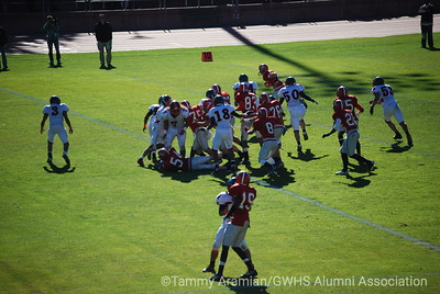 #16 Aram Gevandian (top of frame) with a quarterback sneak end run for a TD in the 3rd quarter.