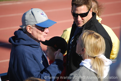 former GW football coach Joe Callan (in hat), Marc Loney, Carrie Wert