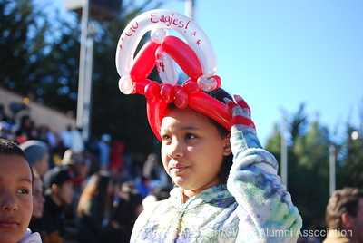 young lady proudly wears a Jonathan-made balloon crown honoring #80 (listed here as #84) Devon White