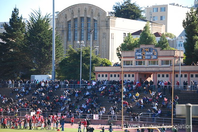 Kezar could easily hold another 5,000 - sadly the crowd was sparser on the GW side. One of Poly High's old gyms in the background.