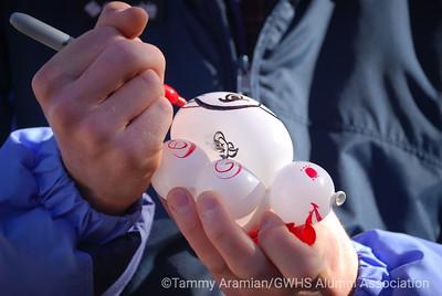 Jonathan the balloon guy embellishes a wrist balloon animal