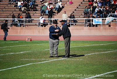 former GW Assistant Principal and then-Visitacion Valley Middle School Principal Jim Dierke honored at halftime by AAA/CIF Athletic Director Don Collins.