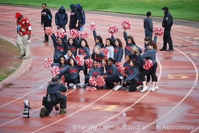 cheerleaders pose for one of the official photogs