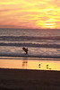 Lone surfer at Mission Beach at sunset