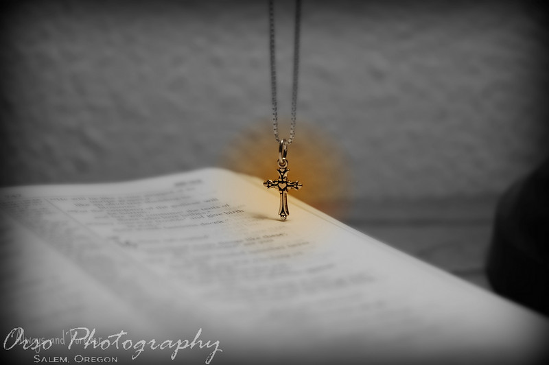 this is a photo i took and gave to my girlfriend, its of a cross necklace i bought for her hanging just above a bible. i really liked the pp affect i added to it and she liked it also!
