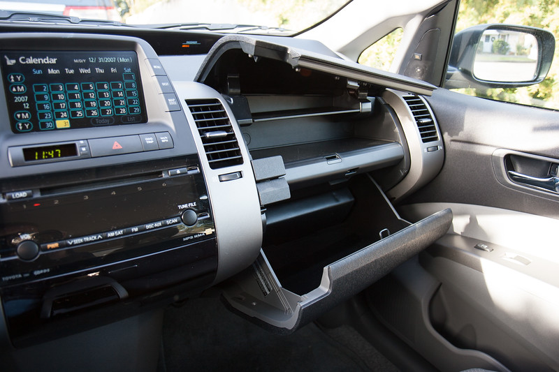 What's the deal with dual glove compartments? Our Honda has 'em, too. I don't even like to wear gloves.