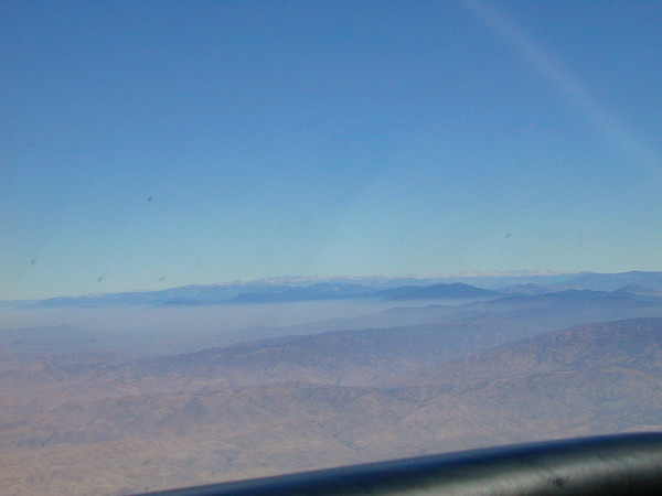 The foothills and Sierra Nevada peaks rise above the haze.