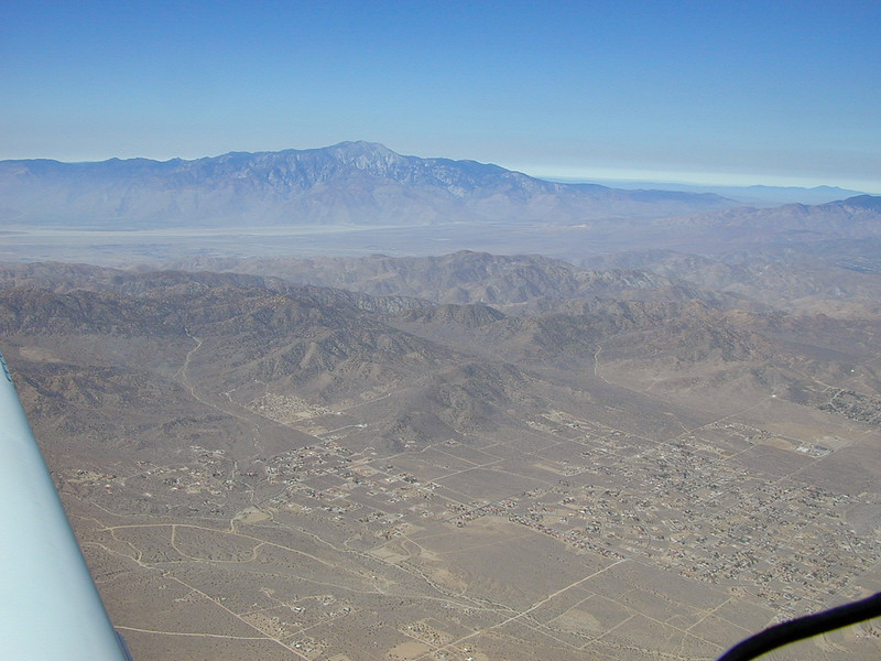Looking southwest towards Palm Springs & San Jacinto Peak. I think the small town in the foreground is Joshua Tree.