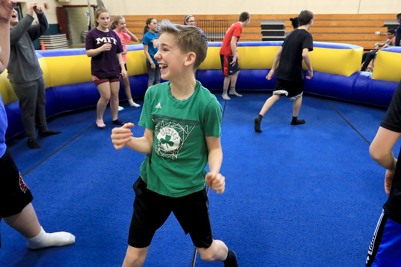 Seventh graders at Overlook Middle School learned about Gaga Ball, in their gym class, a popular game that's played at Summer Camps on Tuesday, March 5, 2019. Seventh grader Ethan Williams has fun playing Gag Ball in Doris Matthews' gym class on Tuesday. SENTINEL & ENTERPRISE/JOHN LOVE