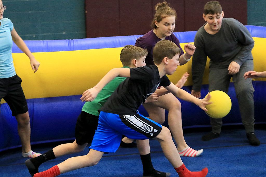 . Seventh graders at Overlook Middle School learned about Gaga Ball, in their gym class, a popular game that\'s played at Summer Camps on Tuesday, March 5, 2019. Seventh graders in Doris Matthews gym class play Gag Ball on Tuesday. SENTINEL & ENTERPRISE/JOHN LOVE