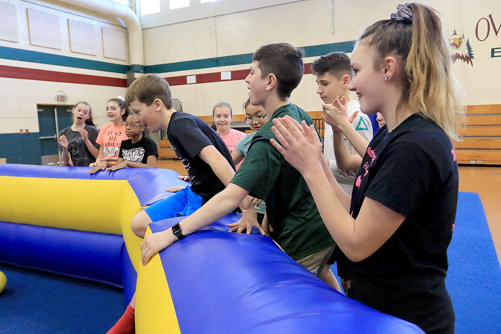 . Seventh graders at Overlook Middle School learned about Gaga Ball, in their gym class, a popular game that\'s played at Summer Camps on Tuesday, March 5, 2019. Seventh graders cheer from the side lines for their classmates that where still playing Gaga Ball. SENTINEL & ENTERPRISE/JOHN LOVE