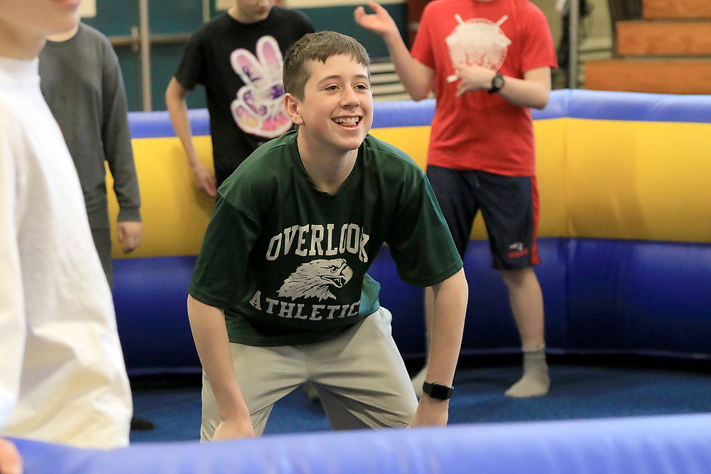 . Seventh graders at Overlook Middle School learned about Gaga Ball, in their gym class, a popular game that\'s played at Summer Camps on Tuesday, March 5, 2019. Seventh grader Mike McCullin waits for a ball to be thrown into play during his gym class as he and his classmates play Gaga Ball on Tuesday. SENTINEL & ENTERPRISE/JOHN LOVE