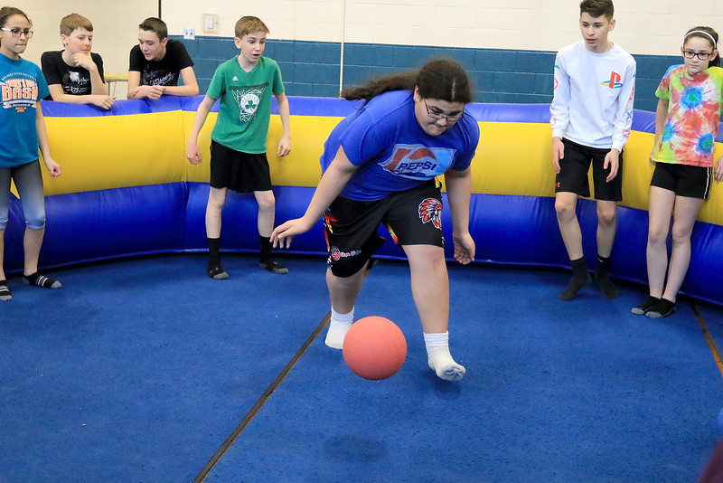 Seventh graders at Overlook Middle School learned about Gaga Ball, in their gym class, a popular game that's played at Summer Camps on Tuesday, March 5, 2019. Seventh grader Ryan Mayne plays some Gaga ball with his fellow classmates in their gym class on Tuesday. SENTINEL & ENTERPRISE/JOHN LOVE