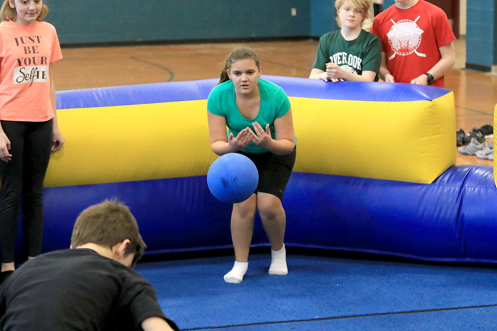 . Seventh graders at Overlook Middle School learned about Gaga Ball, in their gym class, a popular game that\'s played at Summer Camps on Tuesday, March 5, 2019. Seventh grader Molly McDaniel plays some Gaga ball with her fellow classmates in their gym class on Tuesday. SENTINEL & ENTERPRISE/JOHN LOVE