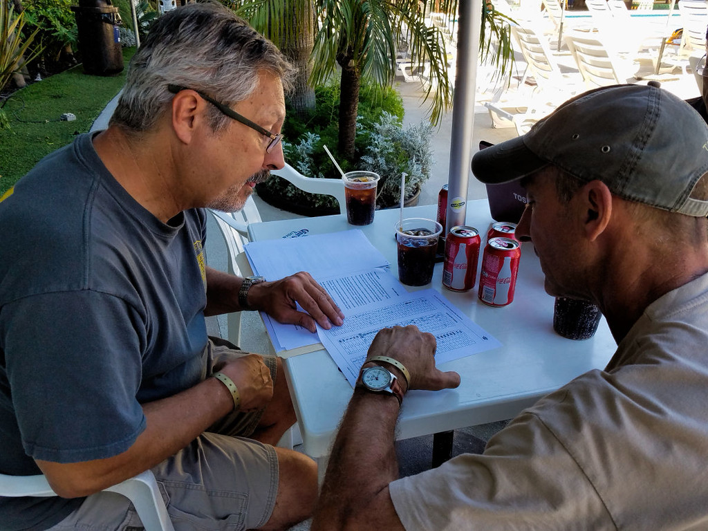 Larry and Bob reviewing the road book symbols