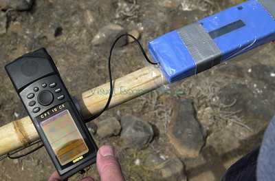 AVID pit tag reader with long wand extension and GPS unit for marking location