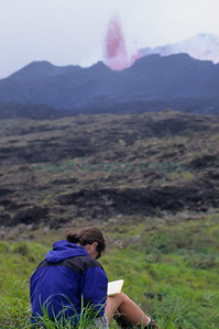 Rachel taking field notes during volcanic eruption