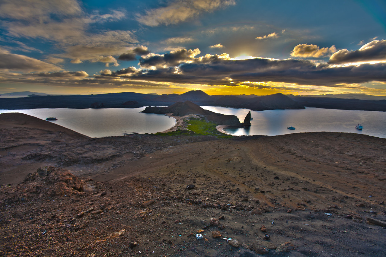HDR5: Bartholomew is a very well formed extinct volcano with a walking trail to the top with dramatic panoramic views, including the famous Pinnacle Rock (at the mouth of the bay on the right).