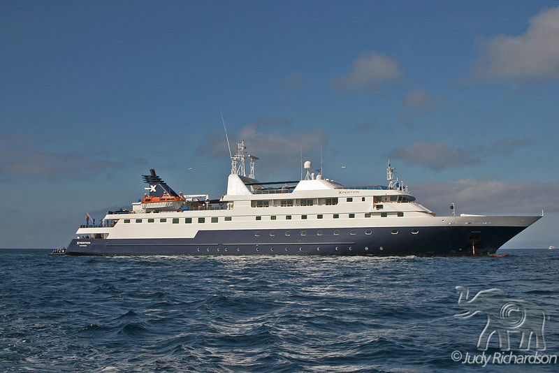 Celebrity Expedition cruise ship with zodiac at the back