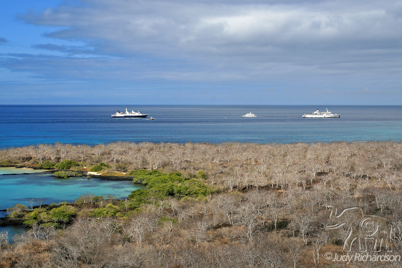 View of ships visiting Floreana Island