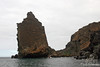 Pinnacle rock formation with zodiac at Bartolome Island~Galapagos, Ecuador